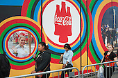 Pedestrians walk past Coca-Cola advertising on route to the London 2102 Olympic Park in Stratford.