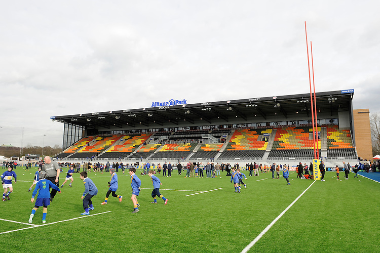 20130216 Copyright onEdition 2013©.Free for editorial use image, please credit: onEdition..Young rugby players from the local community enjoy playing on the artificial pitch before the Premiership Rugby match between Saracens and Exeter Chiefs at Allianz Park on Saturday 16th February 2013 (Photo by Rob Munro)..For press contacts contact: Sam Feasey at brandRapport on M: +44 (0)7717 757114 E: SFeasey@brand-rapport.com..If you require a higher resolution image or you have any other onEdition photographic enquiries, please contact onEdition on 0845 900 2 900 or email info@onEdition.com.This image is copyright onEdition 2013©..This image has been supplied by onEdition and must be credited onEdition. The author is asserting his full Moral rights in relation to the publication of this image. Rights for onward transmission of any image or file is not granted or implied. Changing or deleting Copyright information is illegal as specified in the Copyright, Design and Patents Act 1988. If you are in any way unsure of your right to publish this image please contact onEdition on 0845 900 2 900 or email info@onEdition.com