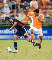 Houston Dynamo midfielder Ricardo Clark jumps over Chivas USA forward Juan Pablo Garcia.  Houston Dynamo beat CD Chivas USA 2-0 at Robertson Stadium in Houston, TX on October 29, 2006 to gain a berth in the Western Conference Final on a 3-2 aggregate.