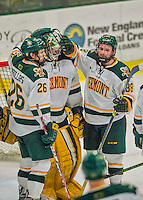 20 February 2016: University of Vermont Catamount Forward Jonathan Turk (right), a Senior from Calgary, Alberta, and Defenseman Trey Phillips (left), a Sophomore from Okotoks, Alberta, give Goaltender Packy Munson, a Freshman from Hugo, MN, a conciliatory pat after the game against the Boston College Eagles at Gutterson Fieldhouse in Burlington, Vermont. The Eagles defeated the Catamounts 4-1 in the second game of their weekend series. Mandatory Credit: Ed Wolfstein Photo *** RAW (NEF) Image File Available ***