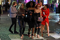 Pictured: Four young women walk on Wind Street, Swansea, Wales, UK. Friday 20 December 2019<br /> Re: Black Eye Friday (also known as Black Friday, Mad Friday, Frantic Friday) the last Friday before Christmas, in Swansea, Wales, UK.