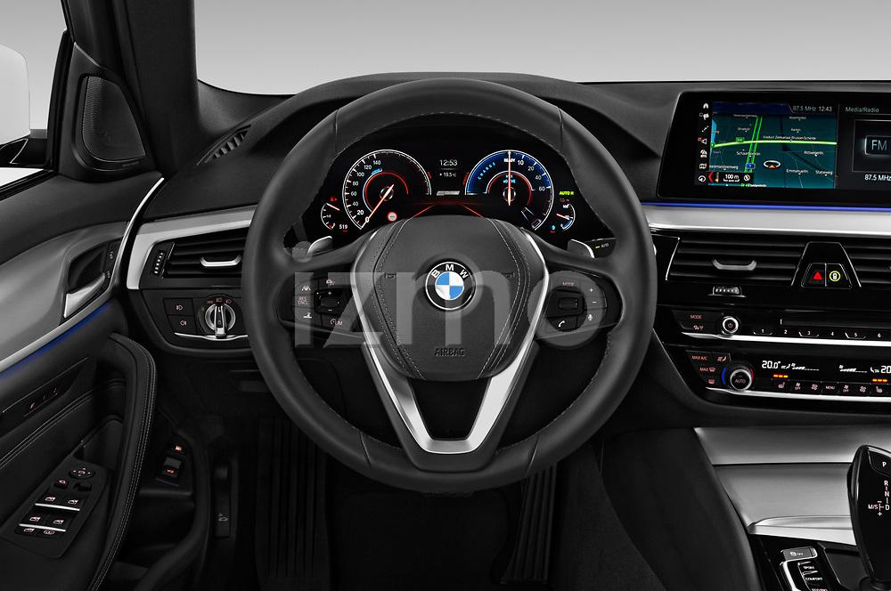 Car pictures of steering wheel view of a 2018 BMW 5 Series Plug-In Hybrid 530e Sport 4 Door Sedan