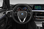 Car pictures of steering wheel view of a 2018 BMW 5 Series Plug-In Hybrid 530e Sport 4 Door Sedan