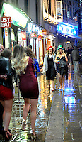 Pictured: Women walk down Wind Street in the early hours of New Year's Day. Sunday 01 January 2017<br />Re: Revellers out celebrating the New Year in the pub and club on Wind Street Swansea