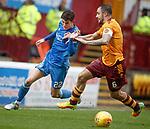 Ryan Christie tries to run around Peter Hartley