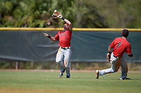 Ball State Cardinals center fielder Aaron Simpson (1) catches a fly ball as Noah Navarro (8) looks on during a game against the Mount St. Mary's Mountaineers on March 9, 2019 at North Charlotte Regional Park in Port Charlotte, Florida.  Ball State defeated Mount St. Mary's 12-9.  (Mike Janes/Four Seam Images)