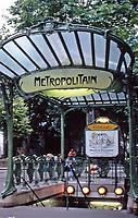 Metro Station entrance at Palais Royal/Musee du Louvre Metro stop with Musee du Louvre beyond, Paris France<br /> Hector Guimard