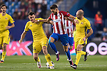 Yannick Ferreira Carrasco (c) of Atletico de Madrid fights for the ball with Aleksandr Gatskan (l) and Timofei Kalachev of FC Rostov during their 2016-17 UEFA Champions League match between Atletico Madrid and FC Rostov at the Vicente Calderon Stadium on 01 November 2016 in Madrid, Spain. Photo by Diego Gonzalez Souto / Power Sport Images