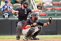 Kannapolis Intimidators catcher Michael Marjama (23) frames the ball as home plate umpire Junior Valentine calls a batter out on strikes during the South Atlantic League game against the Rome Braves at CMC-Northeast Stadium on August 5, 2012 in Kannapolis, North Carolina.  The Intimidators defeated the Braves 9-1.  (Brian Westerholt/Four Seam Images)