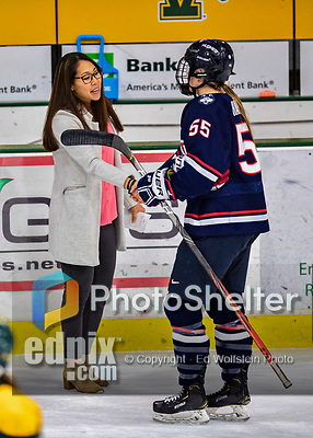 8 February 2020: University of Vermont Catamount Associate Head Coach Jess Koizumi, entering her 3rd season of coaching at Vermont, shakes hands with University of Connecticut Husky Viki Harkness after a game at Gutterson Fieldhouse in Burlington, Vermont. The Huskies defeated the Lady Cats 4-2 in the first game of their weekend Hockey East series. Mandatory Credit: Ed Wolfstein Photo *** RAW (NEF) Image File Available ***