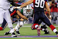 3 December 2009: New York Jets' quarterback Kellen Clemens is sacked in the third quarter by defensive end Aaron Schobel of Buffalo Bills at the Rogers Centre in Toronto, Ontario, Canada. The Jets defeated the Bills 19-13. Mandatory Credit: Ed Wolfstein Photo