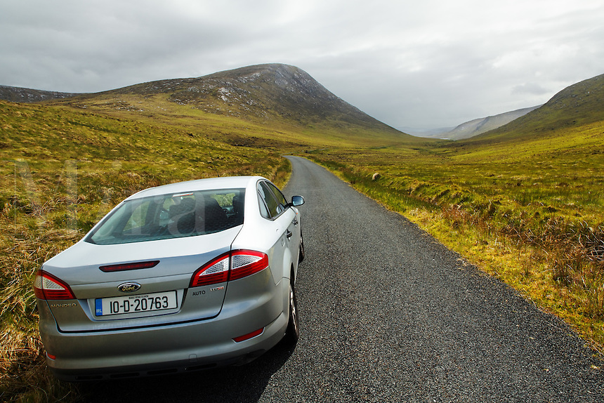 Car on road through Glenveagh National Park countryside, Glendowanbeg, Glendowan, County Donegal, Republic of Ireland