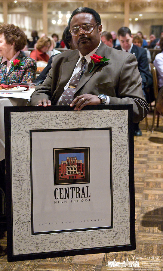 Jefferson Thomas, one of the Little Rock Nine, sits with the framed photo of Central High School in Little Rock signed by its students after delivering the keynote address at the 2009 Westerville, Ohio, MLK Day Celebration. Photo Copyright Gary Gardiner. Not be used without written permission detailing exact usage.