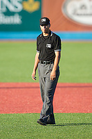 Umpire Christopher Stump handles the calls on the bases during the New York Penn League game between the Brooklyn Cyclones and the Hudson Valley Renegades at Dutchess Stadium on June 18, 2014 in Wappingers Falls, New York.  The Cyclones defeated the Renegades 4-3 in 10 innings.  (Brian Westerholt/Four Seam Images)