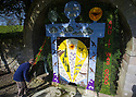05/05/16<br /> <br /> The finishing touches are made to Hall Well.<br /> <br /> The  annual village well dressing season is underway and a team of several volunteers helps erect the first of the traditional floral decorations in the small village of Tissington in the Derbyshire Peak District.<br /> <br /> The Hall Well, one of six in the village to be decorated, shows a traditional biblical scene, The Creation, hand-made with thousands of petals from hydrangeas, statice, carnations, eucalyptus, rosemary, wild garlic, parsley and more unusual additions of coffee beans, sheep wool and feathers.<br /> <br /> Each well dressing takes around five days from start to finish.<br /> <br /> The village, which  has been part of the FitzHerbert family estate for more than 500 years, will see around 350,000 visitors over four days, all wanting to see the spectacular designs.<br /> <br /> While it is thought that the origin of well dressing has its roots in pagan customs, and was later given a Christian meaning, one theory claims that the custom began just after the Black Death in 1348.<br /> <br /> Many villages in Derbyshire were ravaged by the plague, but in Tissington all escaped, and the immunity was ascribed to the purity of the water supply. <br /> <br /> It became the custom to decorate the wells annually as a way of giving thanks.<br /> <br /> <br /> All Rights Reserved: F Stop Press Ltd. +44(0)1335 418365   www.fstoppress.com.