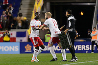 Harrison, NJ - Wednesday Feb. 22, 2017: Bradley Wright-Phillips, Mike Grella during a Scotiabank CONCACAF Champions League quarterfinal match between the New York Red Bulls and the Vancouver Whitecaps FC at Red Bull Arena.