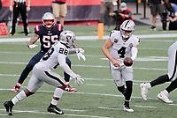 27th September 2020, Foxborough, New England, USA;  Las Vegas Raiders quarterback Derek Carr (4) hands off to Las Vegas Raiders running back Josh Jacobs (28) during the game between the New England Patriots and the Las Vegas Raiders