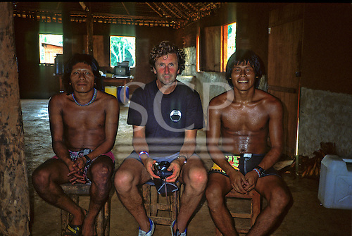 A-Ukre village, Amazon, Brazil. Gordon Roddick of the Body Shop in the village Brazil nut oil factory with the Kayapo managers.
