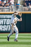 Michigan Wolverines shortstop Jack Blomgren (2) makes a catch during Game 1 of the NCAA College World Series against the Texas Tech Red Raiders on June 15, 2019 at TD Ameritrade Park in Omaha, Nebraska. Michigan defeated Texas Tech 5-3. (Andrew Woolley/Four Seam Images)