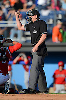 Umpire Mike Provine makes a call during a game between the Batavia Muckdogs and Auburn Doubledays on June 18, 2013 at Dwyer Stadium in Batavia, New York.  Batavia defeated Auburn 10-2.  (Mike Janes/Four Seam Images)