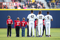Michigan Wolverines outfielders Jordan Nwogu (42), Jordan Brewer (22) and Christian Bullock (5) stand for the national anthem before the NCAA baseball game against the Rutgers Scarlet Knights on April 26, 2019 at Ray Fisher Stadium in Ann Arbor, Michigan. Michigan defeated Rutgers 8-3. (Andrew Woolley/Four Seam Images)