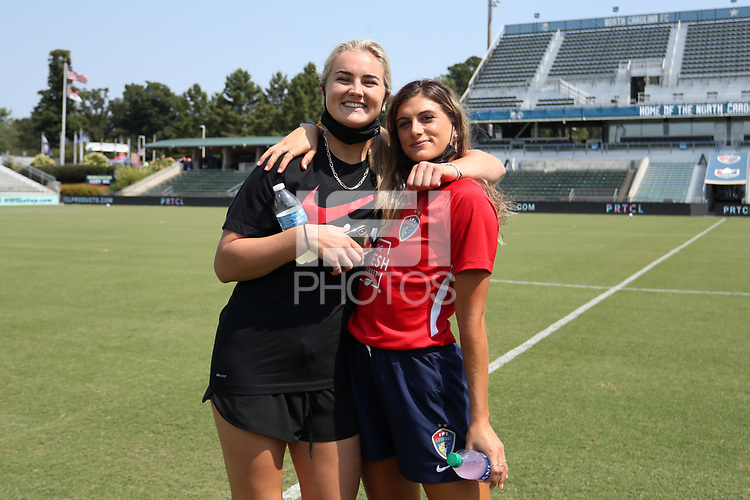 CARY, NC - SEPTEMBER 12: Lindsey Horan #10 of the Portland Thorns FC and Cari Roccaro #21 of the North Carolina Courage embrace before a game between Portland Thorns FC and North Carolina Courage at Sahlen's Stadium at WakeMed Soccer Park on September 12, 2021 in Cary, North Carolina.