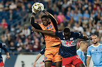 FOXBOROUGH, MA - SEPTEMBER 11: Sean Johnson #1 of New York City FC grabs the ball as Edward Kizza #19 of New England Revolution challenges during a game between New York City FC and New England Revolution at Gillette Stadium on September 11, 2021 in Foxborough, Massachusetts.