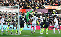 Petr Cech of Arsenal punches away the aerial threat during a Swansea corner in the Premier League match between Swansea City and Arsenal at The Liberty Stadium, Swansea, Wales, UK. Saturday 14 January 2017