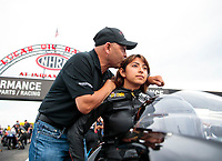 Aug 30, 2019; Clermont, IN, USA; NHRA top fuel driver Mike Salinas (left) kisses daughter pro stock motorcycle rider Jianna Salinas during qualifying for the US Nationals at Lucas Oil Raceway. Mandatory Credit: Mark J. Rebilas-USA TODAY Sports