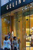 Shoppers walk past Celine on Omotesando in the Harajuku area of Tokyo, Japan. As Japan is seeing the light after over ten years of a stagnant economy public consumer spending is on the increase with new shops and cafes opening and doing well..