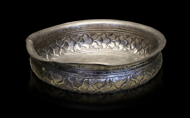 Mycenaean silver cup from the Tomb 78 of the Mycenae chamber tombs, Greece. National Archaeological Museum Athens. Black Background<br /> <br /> This Mycenaean silver cup has a repousse  scale pattern with wish bone handles. Cat No 3121. 16th Cent BC