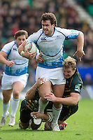 Alex Dunbar of Glasgow Warriors is tackled by Tom May (left) and Rhys Oakley of Northampton Saints during the Heineken Cup match between Northampton Saints and Glasgow Warriors  at Franklin's Gardens on Sunday 14th October 2012 (Photo by Rob Munro)