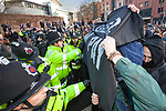 © Joel Goodman - 07973 332324 . 24/11/2010 . Manchester , UK . Police and a black block of protesters clash . Students and their supporters march and demonstrate through Manchester City Centre against government cuts to student support and rising education fees , specifically against an election pledge made by the Liberal Democrats prior to forming the coalition government . Photo credit : Joel Goodman
