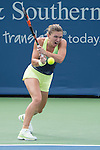 Simone Halep (ROU) splits sets with Kristina Mladenovic (FRA)  7-5, 5-7 at the Western and Southern Open in Mason, OH on August 19, 2015.