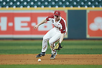 Arkansas Razorbacks first baseman Heston Kjerstad (18) fields a ground ball against the Baylor Bears in game nine of the 2020 Shriners Hospitals for Children College Classic at Minute Maid Park on March 1, 2020 in Houston, Texas. The Bears defeated the Razorbacks 3-2. (Brian Westerholt/Four Seam Images)