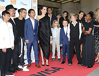RITHY PANH, ANGELINA JOLIE WITH HER CHILDREN MADDOX, PAX, VIVIENNE, KNOX, SHILOH AND ZAHARA - RED CARPET OF THE FILM 'FIRST THEY KILLED MY FATHER' - 42ND TORONTO INTERNATIONAL FILM FESTIVAL 2017