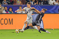 CARSON, CA - SEPTEMBER 15: Daniel Steres #5 of the Los Angeles Galaxy and Erik Hurtado #19 of Sporting Kansas City battle for a loose ball during a game between Sporting Kansas City and Los Angeles Galaxy at Dignity Health Sports Park on September 15, 2019 in Carson, California.