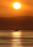 The first ferry out of Sausalito heading for the city of San Francisco was greeted by a sunrise.