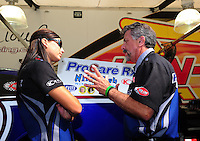 Sept. 30, 2011; Mohnton, PA, USA: NHRA crew member John Medlen (right) talks with funny car driver Leah Pruett during qualifying for the Auto Plus Nationals at Maple Grove Raceway. Mandatory Credit: Mark J. Rebilas-