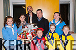 Eabha Dwyer, Chloe McCarthy and Gillian Spillane Torc St Mary Girls Guides, Anne and Maggie Hickey Lissivigeen Brownies and Eimer Furlong Lily Ladybirds who presented food hampers to the Killarney Lions President Sean o'Grady and Martin O'Brien in the Church of the Ressurection hall on Friday night