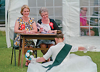 """1968 Queen of Bamford, Kate Gosney judging the deportment of visiting royalty assisted by her daughter ITV Weather Presenter Kerrie Gosney.<br /> <br /> """"Lost property found on carnival day or during the week, one white New Look cardigan size 12, one black CMD cardigan large, one pair of blue shoes size 4, a small child's drinking cup pink and yellow and pink and white flowered hat found together on bench."""""""