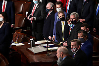 United States Representative Jim Jordan (Republican of Ohio), center, and United States House Minority Leader Kevin McCarthy (Republican of California), right, wear protective masks while listening during a joint session of Congress to count the Electoral College votes of the 2020 presidential election in the House Chamber in Washington, D.C., U.S., on Wednesday, Jan. 6, 2021. Congress is meeting to certify Joe Biden as the winner of the 2020 presidential election, with scores of Republican lawmakers preparing to challenge the tally in a number of states during what is normally a largely ceremonial event. <br /> Credit: Erin Scott / Pool via CNP/AdMedia