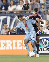 Sporting Kansas City midfielder Graham Zusi (8) intercepts New England Revolution forward Benny Feilhaber (22) dribble. In a Major League Soccer (MLS) match, Sporting Kansas City defeated the New England Revolution, 1-0, at Gillette Stadium on August 4, 2012.