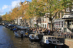 Restaurant alongside a canal and boats in Amsterdam, Netherlands