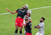 WASHINGTON, DC - NOVEMBER 8: Donovan Pines #23 of D.C. United heads the ball during a game between Montreal Impact and D.C. United at Audi Field on November 8, 2020 in Washington, DC.