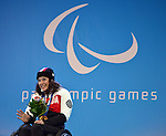 Sochi, Russia, 13/03/2014. Canadian sit skier Kimberly Joines celebrates her Bronze medal win in the women's slalom sitting event at the Sochi 2014 Paralympic Winter Games in Sochi Russia. (Photo: Canadian Paralympic Committee)