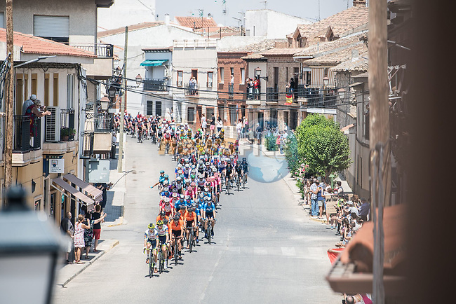 The peloton during Stage 5 of La Vuelta d'Espana 2021, running 184.4km from Tarancón to Albacete, Spain. 18th August 2021.    <br /> Picture: Charly Lopez/Unipublic | Cyclefile<br /> <br /> All photos usage must carry mandatory copyright credit (© Cyclefile | Unipublic/Charly Lopez)