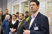 Sir Simon Milton, leader of Westminster City Council, and local residents listen as Marco Torquati, Church Street Neighbourhood Manager for the Paddington Development Trust, speaks at the opening of new neighbourhood offices in Church Street, Paddington, London.