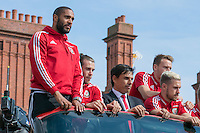 CARDIFF, UK. 8th July 2016. The Welsh football team are welcomed home with a public celebration event after reaching the semi-final of the Euro 2016 championship. After landing at Cardiff airport, an open-top bus parade took them through the city centre.<br /> <br /> L-R: Ashley Williams, Gareth Bale, Chris Coleman, Chris Gunter, Aaron Ramsey