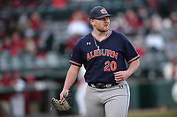 Auburn starter Cody Greenhill returns to the dugout Thursday, April 1, 2021, after the final out of the first inning of play against Arkansas at Baum-Walker Stadium in Fayetteville. Visit nwaonline.com/210402Daily/ for today's photo gallery. <br /> (NWA Democrat-Gazette/Andy Shupe)